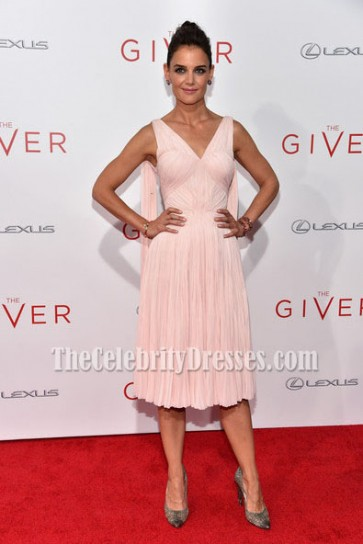 Actress Katie Holmes attends 'The Giver' premiere at Ziegfeld Theater on August 11, 2014 in New York City. She looked Amazing in this pale pink sleeveless micro-pleated dress with cape-like detail.