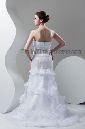 Trumpet/Mermaid Strapless Embroidered Wedding Dresses