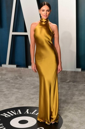 Eiza Gonzalez shimmered in a slinky gold mermaid long evening dress with the high neckline at the 2020 Vanity Fair Oscar party.