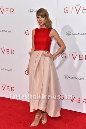 Actress Taylor Swift attends 'The Giver' premiere at Ziegfeld Theater on August 11, 2014 in New York City.  She looks beautiful as usual in this satin gown featuring a draped skirting.