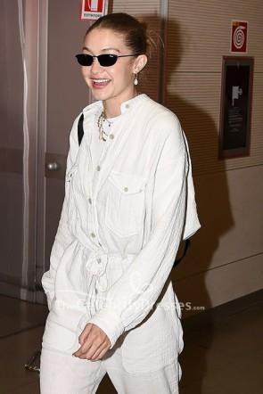 Gigi Hadid White Pockets Jumpsuit Florence Airport