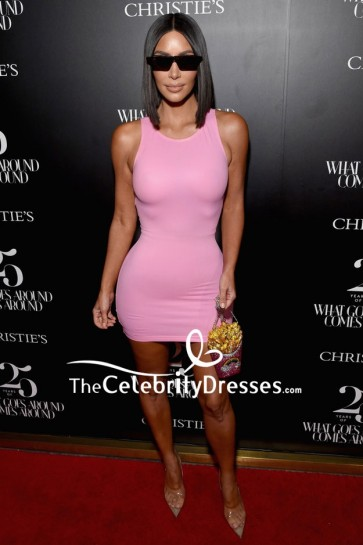 Kim Kardashian flaunted her famous curves in a pink bodycon short dress at the Christie's x What Goes Around Comes Around 25th-anniversary auction preview. So sexy!