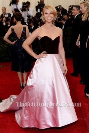 Claire Danes attends the 'Charles James: Beyond Fashion' Costume Institute Gala at the Metropolitan Museum of Art on May 5, 2014 in New York City. She looked Amazing in this strapless burgundy and pink gown.