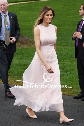 Melania Trump was in a pearl pink sleeveless tea-length organza dress at the White House Easter Egg Roll!