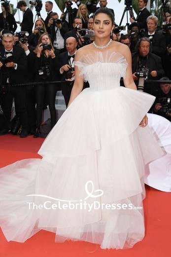 Toni Garrn went for classic elegance in a draped white ruffled formal dress at the 2019 Cannes Film Festival screening of 'A Hidden Life.'