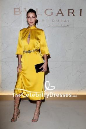 Bella Hadid Yellowがスリーブ付きのパーティードレスをカットブルガリドバイリゾートのグランドオープン