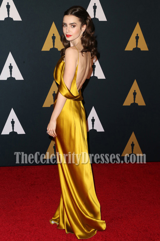Lily Collins Gold Asymmetrical Spaghetti Strap Evening Gown 8th Annual Governors Awards Thecelebritydresses